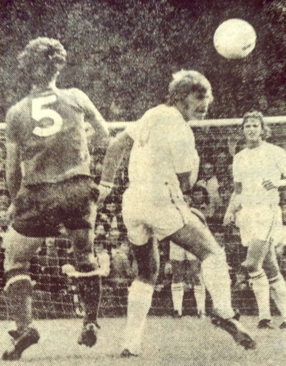 Fred Binney flashes a header wide after beating Derek Jeffries.