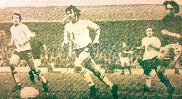 The goal that put Brighton out of the FA Cup: Leatherhead's Chris Kelly (right) hits the 65th minute winner