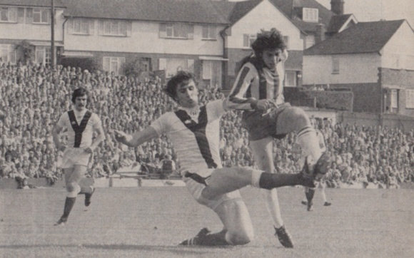 Peter Ward beats a defender to get in a shot.