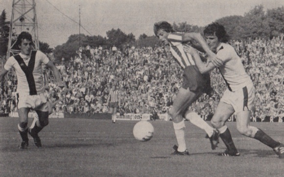 Ian Mellor goes through despite being impeded by the York defenders.