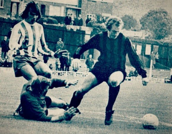 With the halifax goalkeeper on the ground, Beamish loses the ball to Pickering.