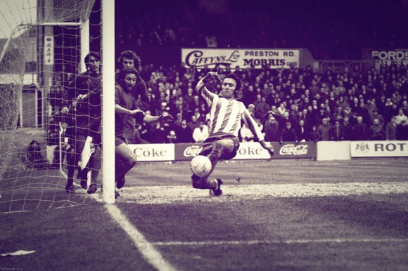 Walton and Hersham goalkeeper Gary Bloom misses a cross, as Barry Bridges just fails to score at the near post.