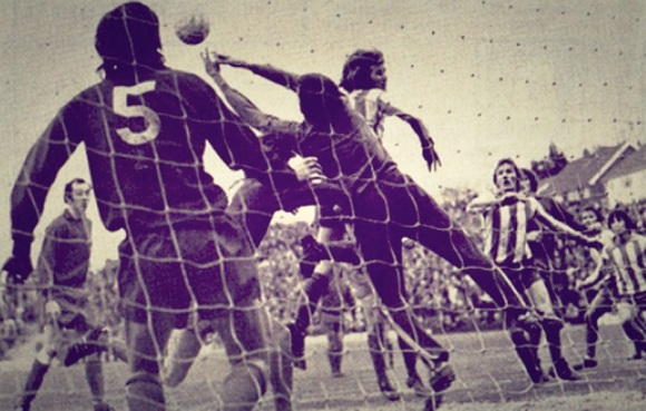 Ronnie Howell challenges for a high ball in the Walton goalmouth, with Lammie Robertson in attendance