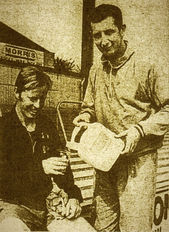 Skipper Nobby Lawton has his energy drink poured by manager Freddie Goodwin