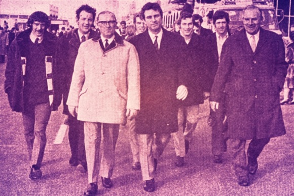 Club officials and players lead the sponsored walk: Kit Napier, Terry Williams, Mr Tom Whiting (Chairman), Peter Dinsdale, Pat Saward (Manager), Norman Gall, Alex Sheridan, Mr Len Stringer (Director).