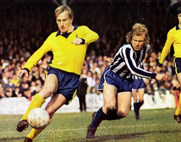 Eddie Spearritt challenges for the ball with Villa's Ray Graydon