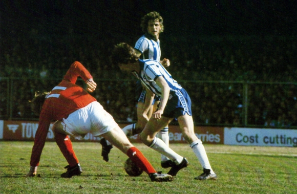 Lawrenson uses his skill to put Gary Churchouse off balance, while Rollings covers the space behind.