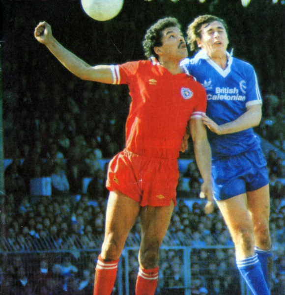 Future Albion defender Larry May in a duel with scorer Michael Robinson