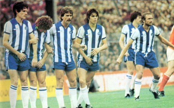 Mark Lawrdnson has just fouled Liam Brady... and nervous Brighton form the inevitable wall.