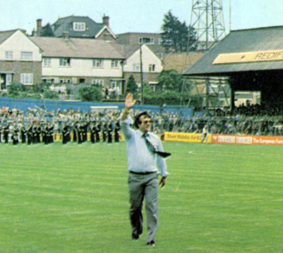 Striking up the band... Alan Mullery salutes the Goldstone crowd before the match. Despite their vociferous support, Albion failed to deliver any points on their big day.