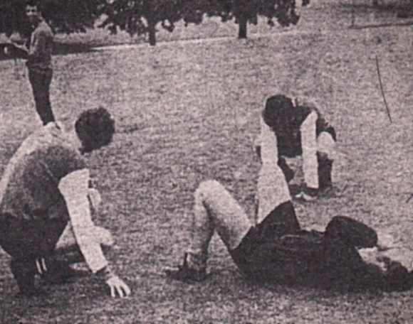 Geoff Sidebottom has collapsed, while Dave Turner (right) and Kit Napier sink to their knees.